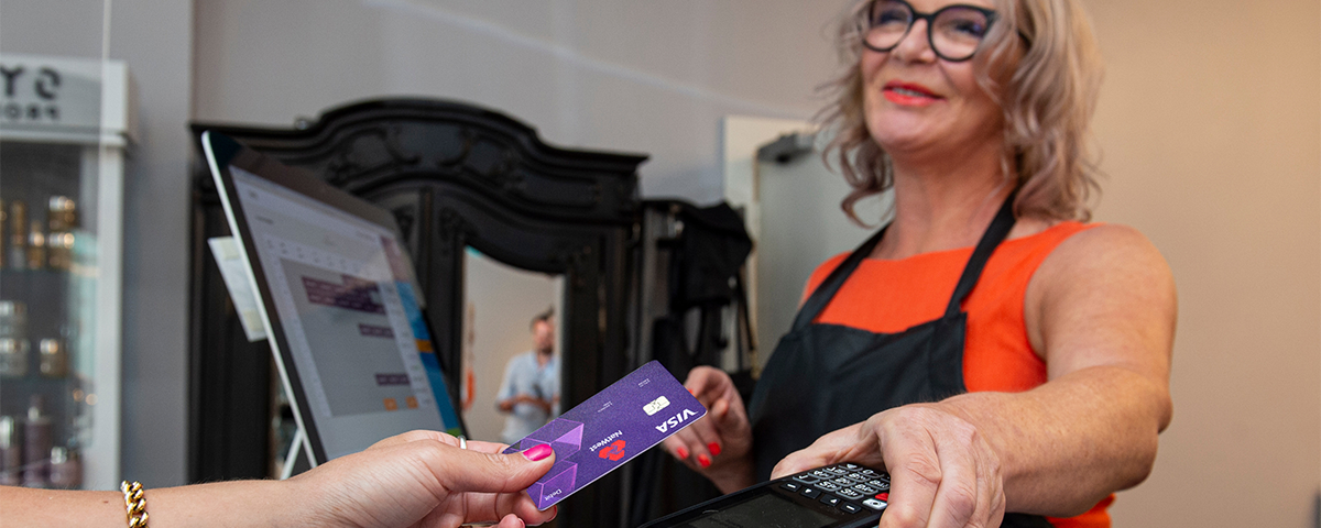 Shop owner taking a contactless payment
