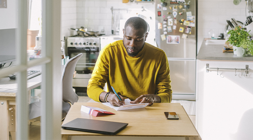 Man working at kitchen table