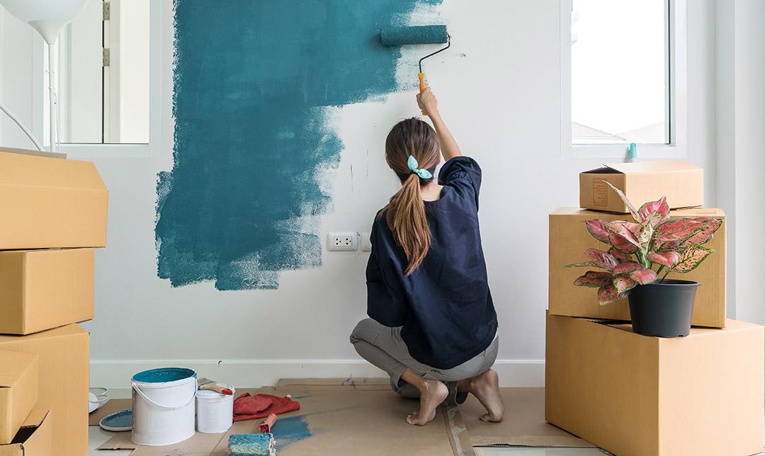 Woman making home improvements