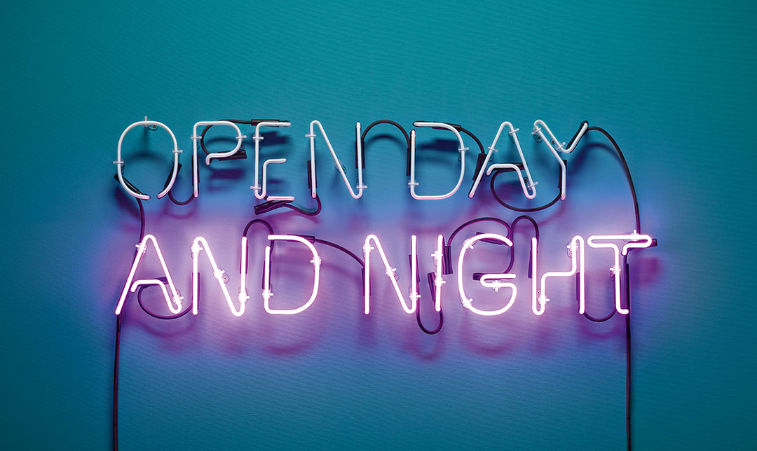 "Image of a neon sign indicating ""Open Day and Night"""
