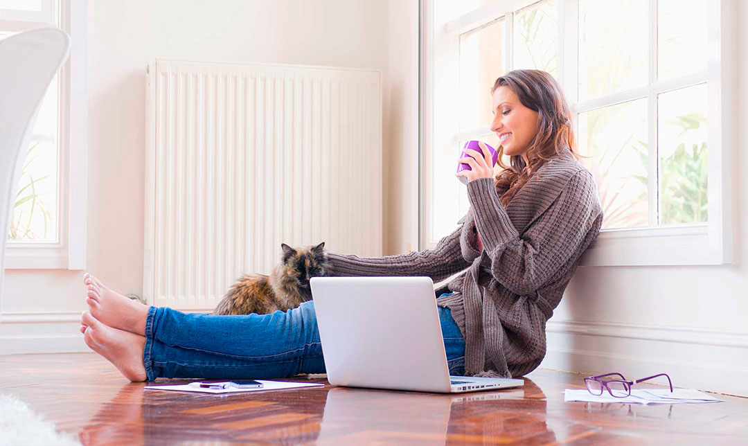 Image of a woman at home using NatWest Online Banking