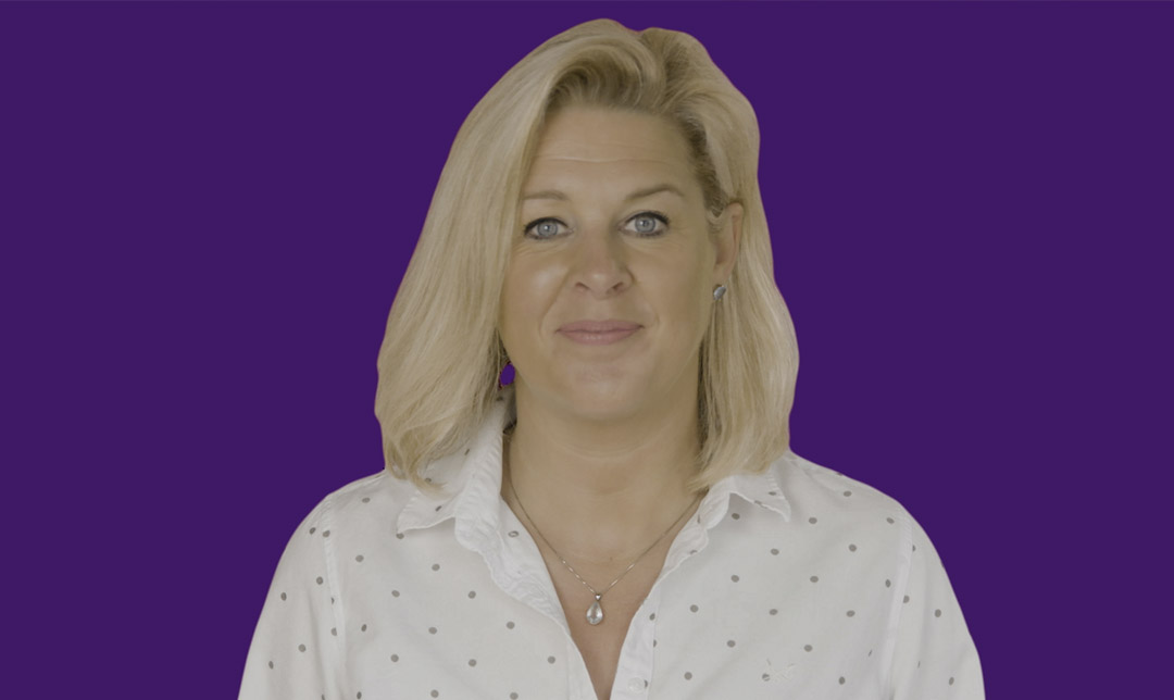Businesswoman in front of purple background