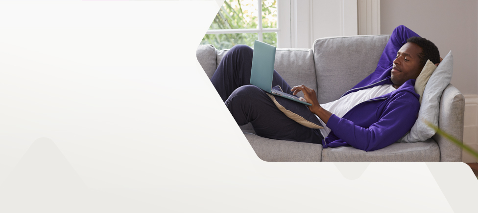 Man relaxing on a sofa while researching NatWest mortgages