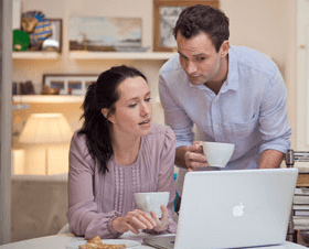 couple-at-home-on-laptop-carousel